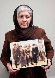 Tajwar holding a picture of her father (far left)